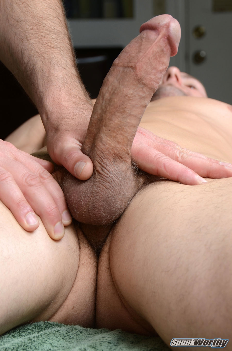 Muscled Bald Dude Gets Hot Fellatio Through Gloryhole